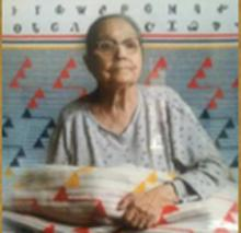Roxanne Standingdeer Stamper (1911-2011.) She created the Road to Soco design, pictured here as a pattern on a Pendleton blanket.