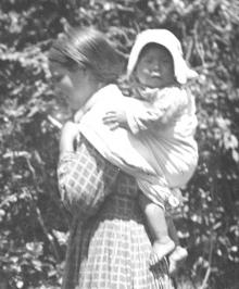 Cherokee woman carrying baby in the traditional way